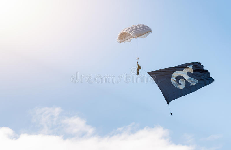Military parachutist with traditional Thai alphabet number nine. On flag royalty free stock photos