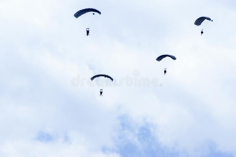 Military parachutists in the sky stock images