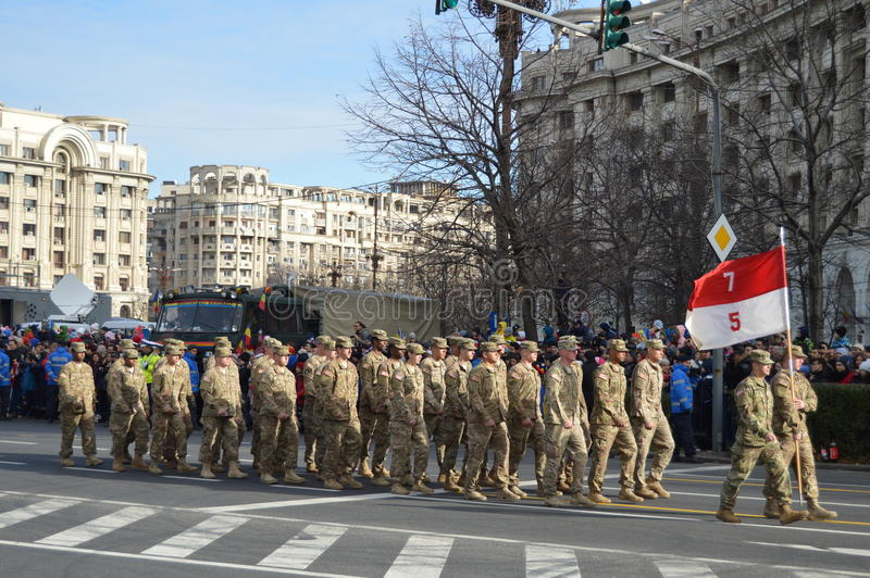 Military parade with american military. Bucharest, Romania, 01 December 2015 : Romanian's National Day parade. Military platoons , technical, police cars and stock photography