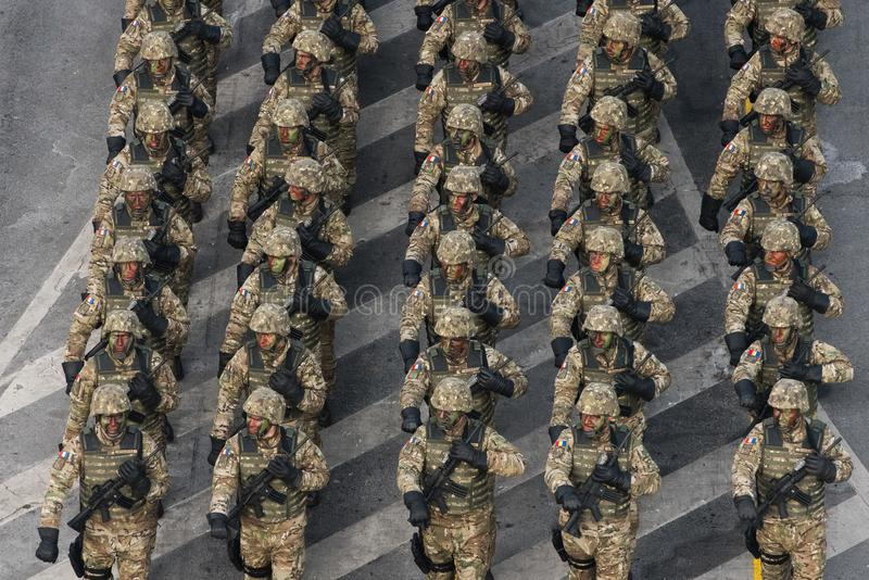 Military parade celebrating Romania`s National Day. Bucharest, Romania - December 01, 2018: Romanian Army`s soldiers march in front of the Triumph Arch during a royalty free stock photography