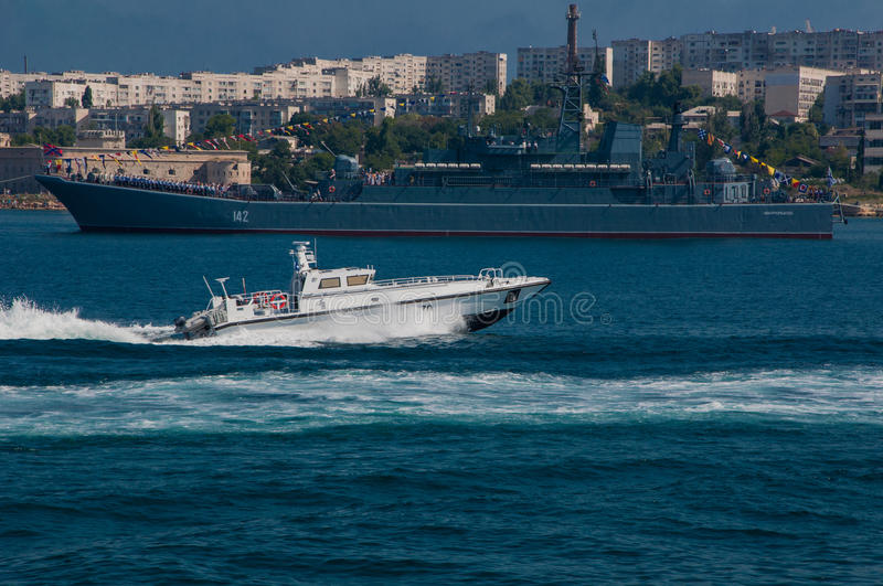Military parade of ships in the Navy Day in Russia in Sevastopol. Exercises in the bay of Sevastopol in Russia stock image