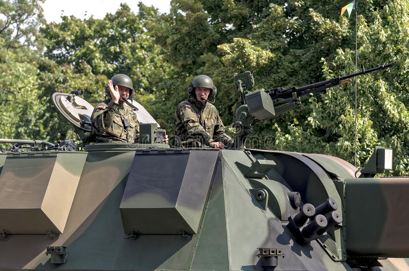 Military parade - Tank crew. Warsaw, Poland - August 15, 2014: Crew of Polish main battle tank LEOPARD during a military parade royalty free stock images