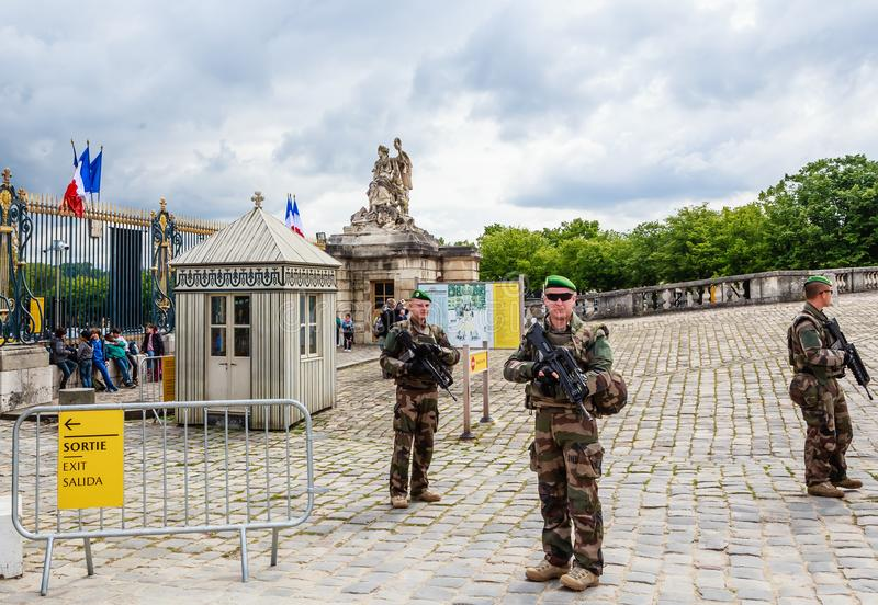 Military patrol, keeping the order, near Main entrance of Versailes royalty free stock images