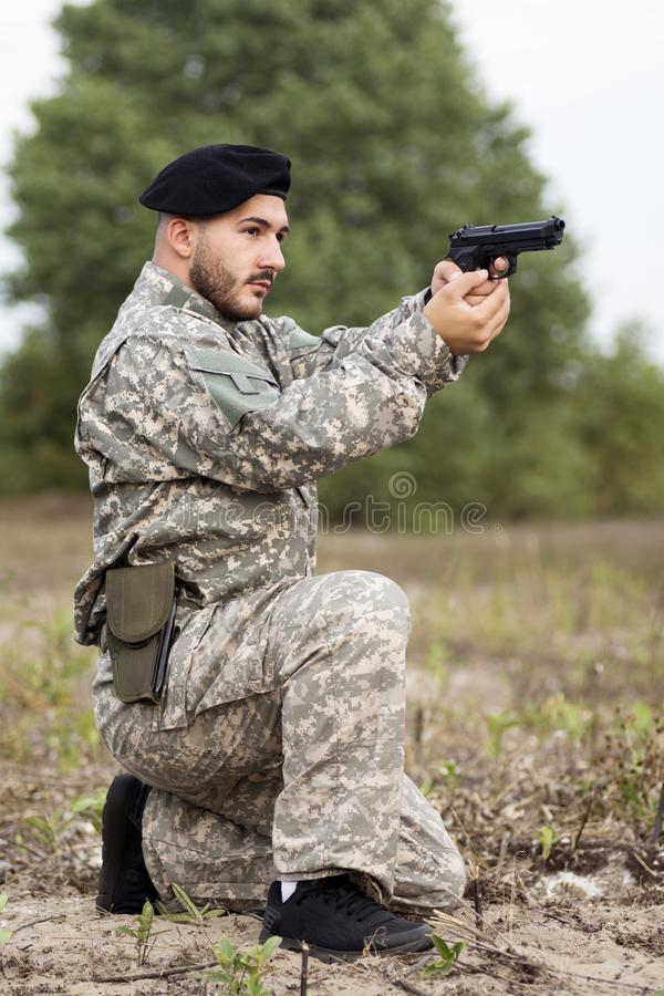 Military person holding pistol stock photos