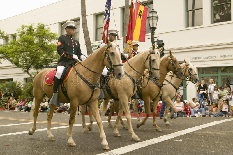 Military personnel on horseback participate at the opening day parade down State Street of Old Spanish Days Fiesta held every. August in Santa Barbara stock photos
