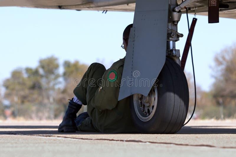 Military pilot. Next to the wheel of the plane royalty free stock photos