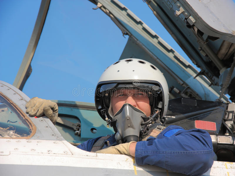Military pilot. In a helmet on a aircraft royalty free stock images