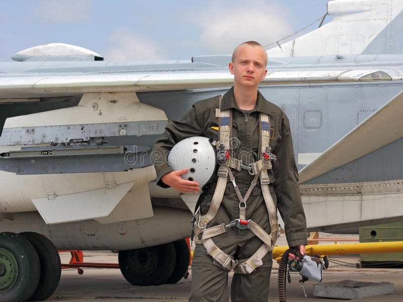 Military pilot. In a helmet near the aircraft stock photography
