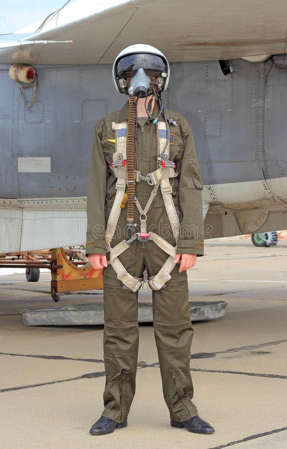 Military pilot. In a helmet near the aircraft stock photo