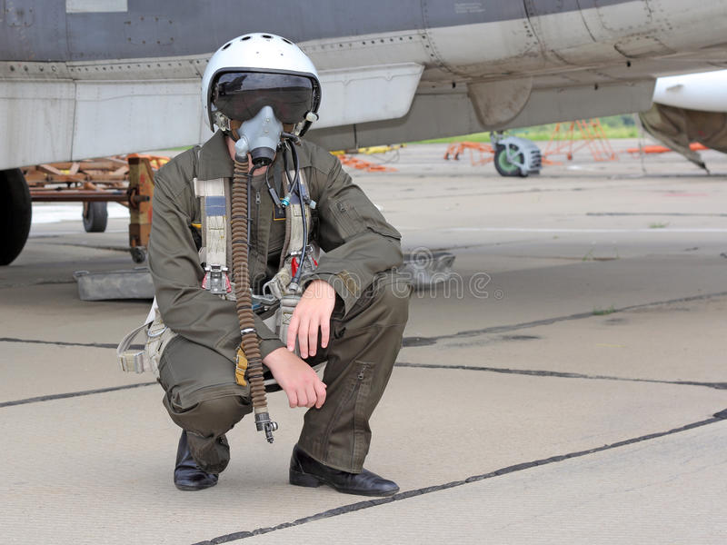Military pilot. In a helmet near the aircraft stock photos