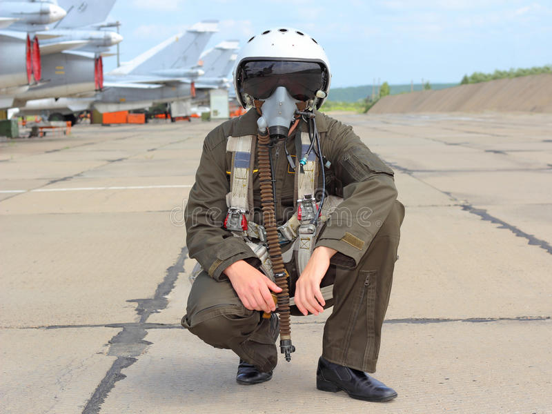 Military pilot. In a helmet near the aircraft royalty free stock image