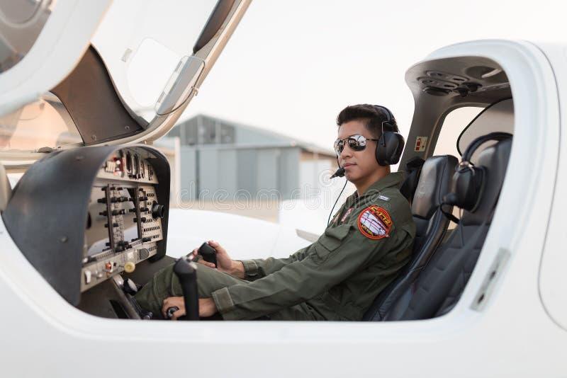 Military pilot on the aircraft. Bangkok, Thailand - March 12, 2016: Military pilot on the aircraft royalty free stock images