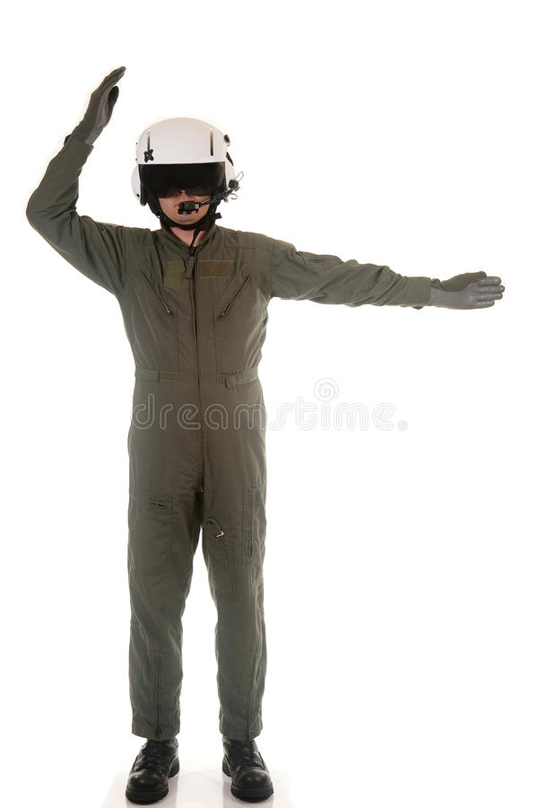Military pilot marshaling aircraft. Military pilot with white helmet marshaling aircraft on a white background royalty free stock photography