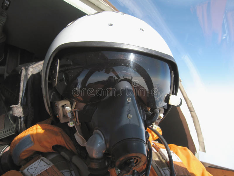 The military pilot in the plane stock image