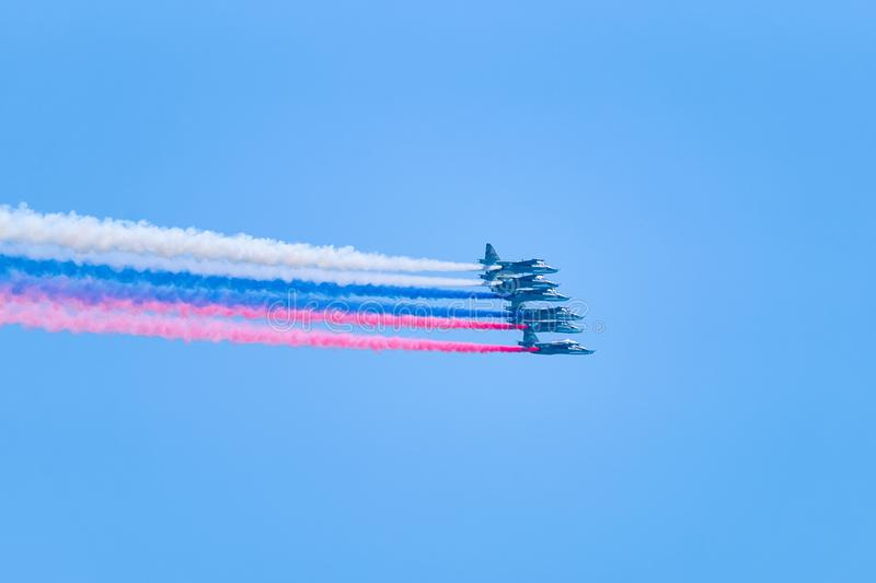 Military plane aircrafts flight russian flag. Military plane aircrafts flight in the blue sky. Making a russian flag colors in the air stock photography
