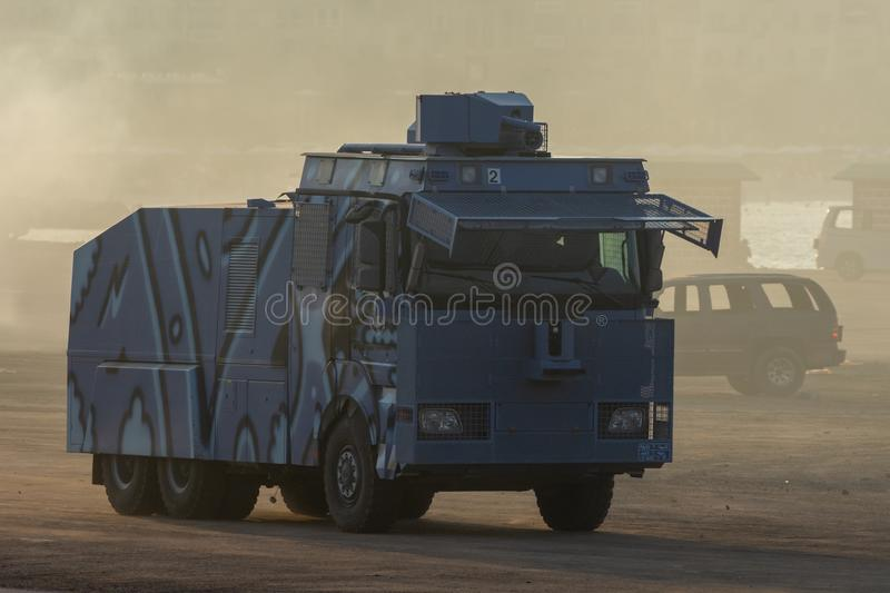 Military police vehicles enforcing law and order in protest, war, and conflict driving across the desert royalty free stock images