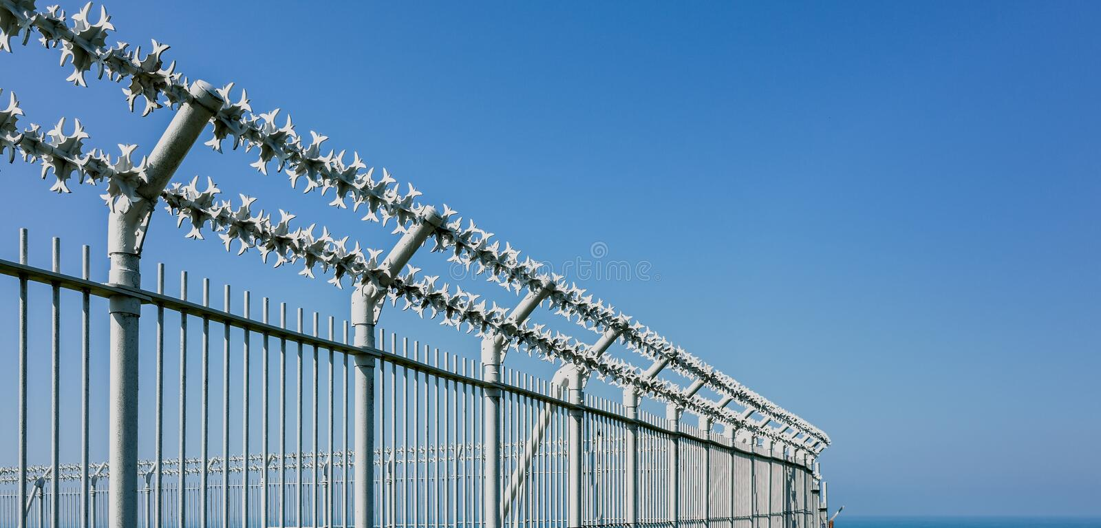 Military Razor Wire Security Fence Stock Photo - Image of wire ...
