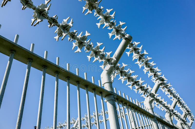 Military Razor Wire Security Fence Stock Photo - Image of blue ...