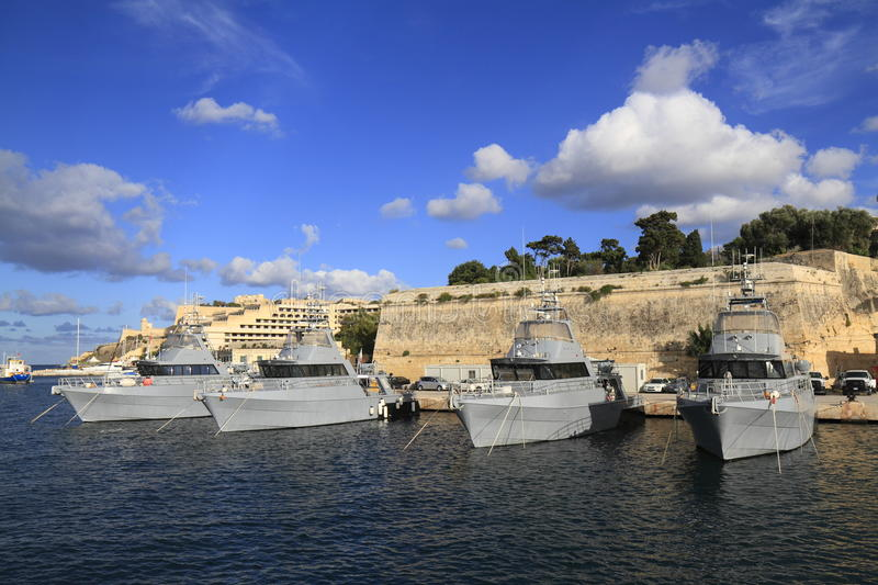 Military Ship in the Grand Harbour of Valletta. In Malta royalty free stock photography