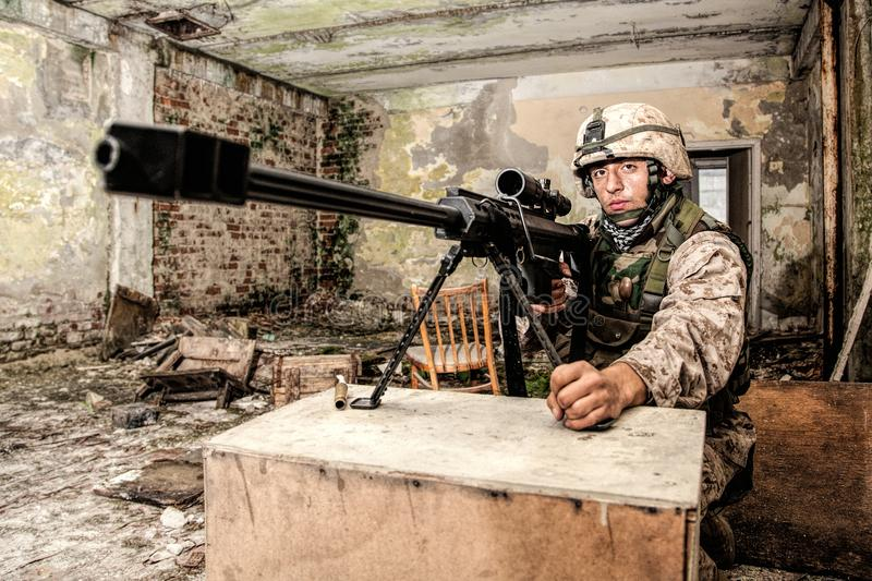 Marine Corps sniper with large caliber rifle royalty free stock photography