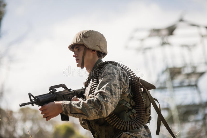 Military soldier standing with a rifle royalty free stock photography
