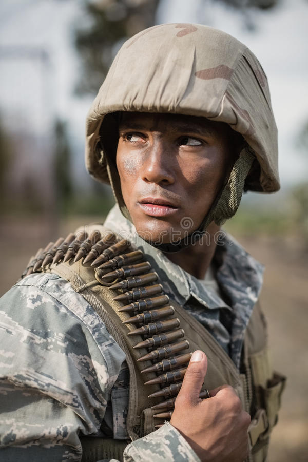Military soldier during training exercise with weapon. At boot camp stock image