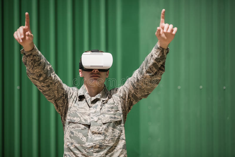 Military soldier using virtual reality headset royalty free stock images