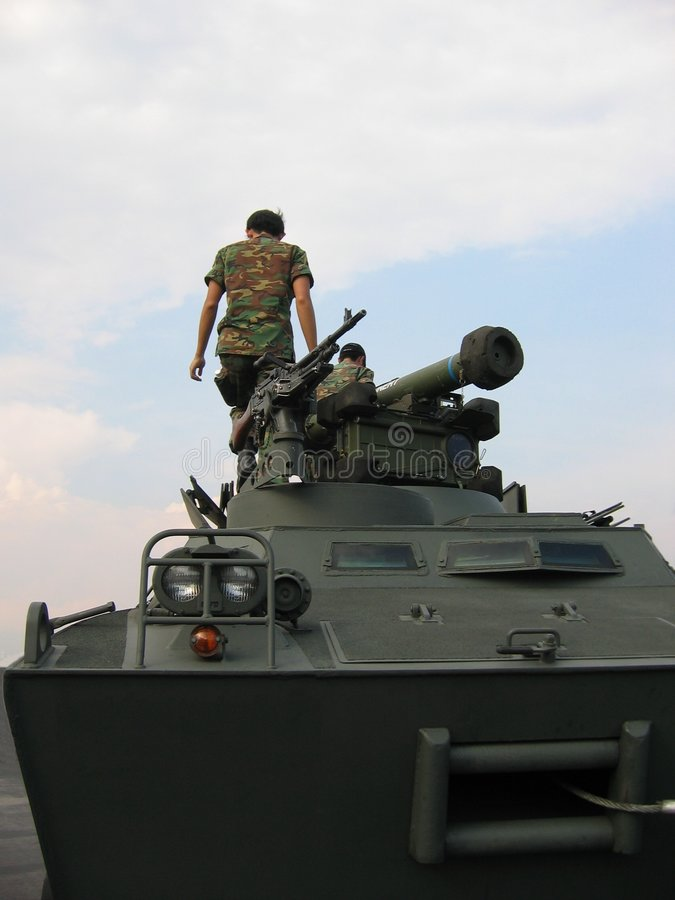 Military - soldiers on tank with machine gun royalty free stock image