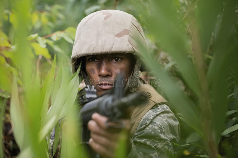 Military soldiers during training exercise with weapon. At boot camp stock photos