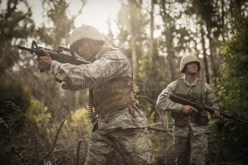 Military soldiers during training exercise with weapon. At boot camp royalty free stock photography