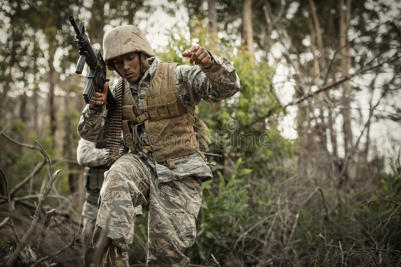 Military soldiers during training exercise with weapon. At boot camp stock photography