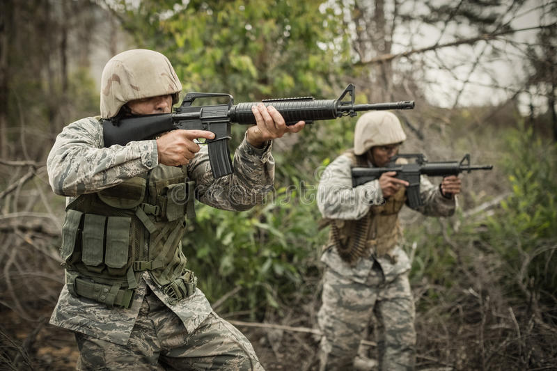 Military soldiers during training exercise with weapon. At boot camp royalty free stock photo