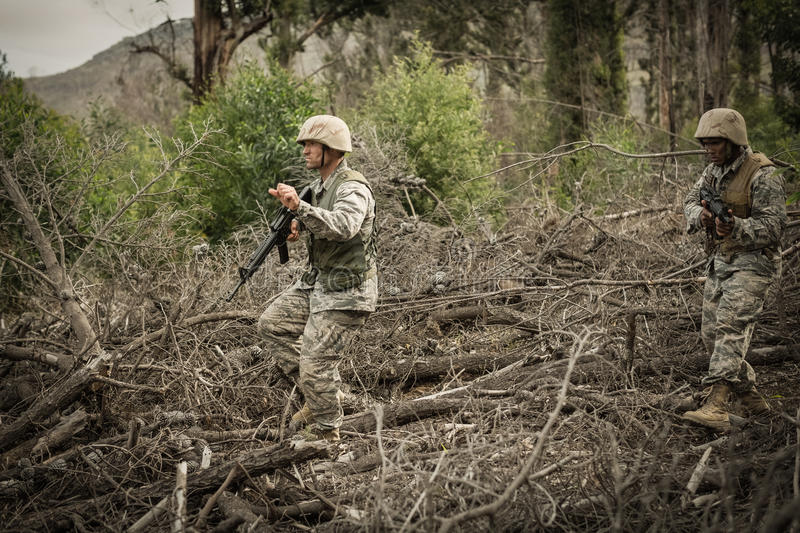 Military soldiers during training exercise with weapon. At boot camp stock image
