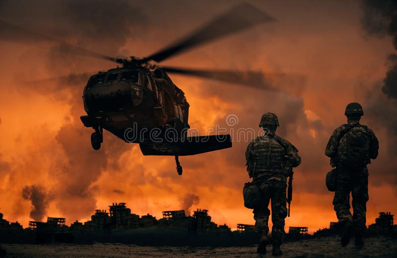 Military soldiers walking to helicopter royalty free stock photography