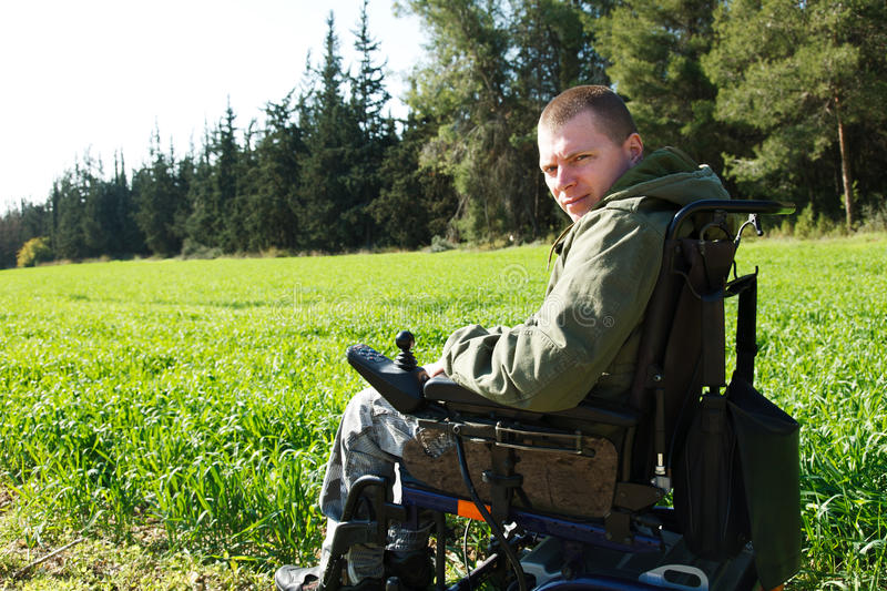 Military soldiers in Wheel-chair. royalty free stock photography