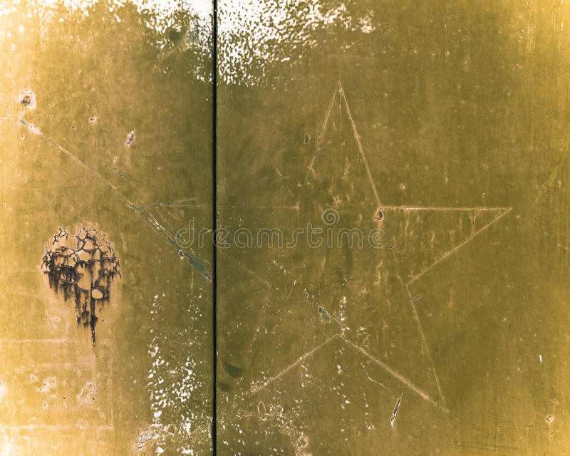 Military Star. Rusted abandoned military storage building marked with a faded star and other interesting textures royalty free stock image
