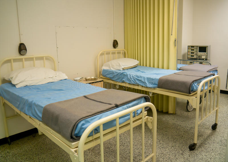Military style hospital beds royalty free stock photos