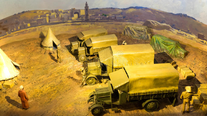Military supplies. Transporting military supplies during the earlier world war. The miniature models display men unloading cargo from trucks stock photography