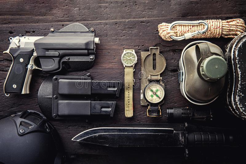 Military tactical equipment for the departure. Assortment of survival hiking gear stock photo