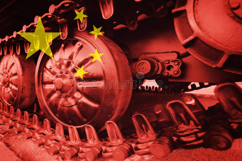 Military tank close-up Caterpillar Track with Chinese flag Background. stock image
