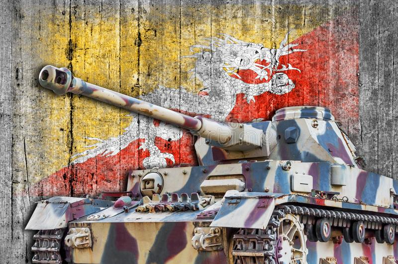 Military tank with concrete Bhutan flag royalty free stock image