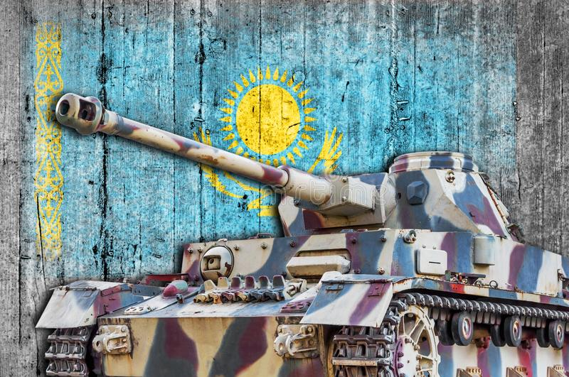 Military tank with concrete Kazakhstan flag royalty free stock image