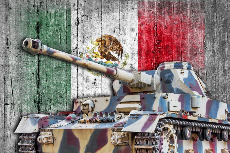 Military tank with concrete Mexico flag. Armored army attack vehicle royalty free stock image