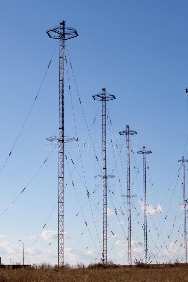 Military telecommunication towers. Against blue sky stock photos