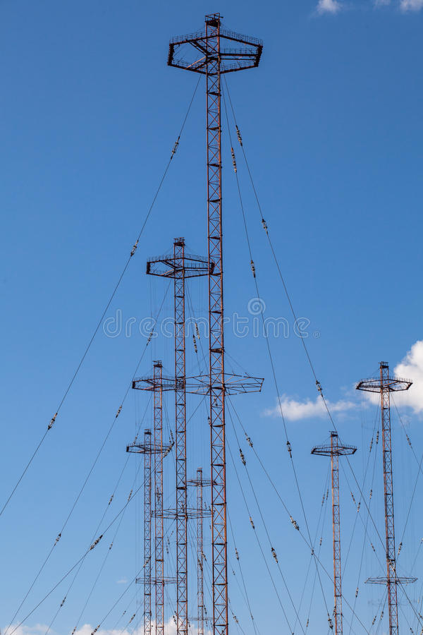 Military telecommunication towers. Against blue sky stock images