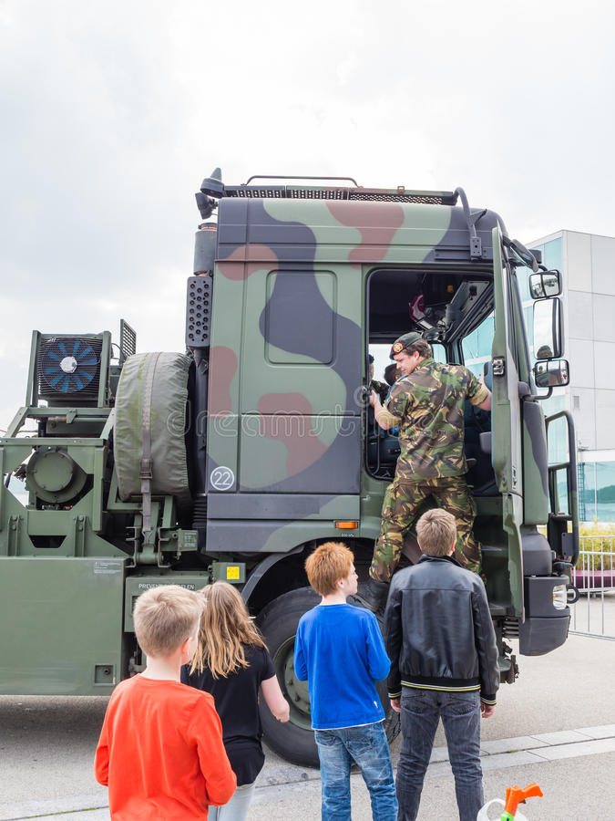 MIlitary tow truck. ALMERE, NETHERLANDS - 23 APRIL 2014: Dutch military tow truck on display during the National Army Day in Almere can be inspected by the royalty free stock photos