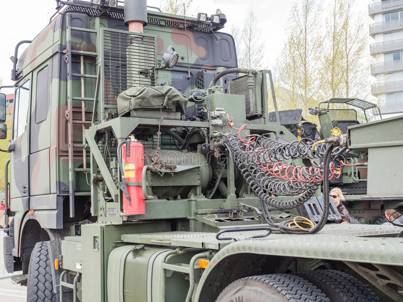 MIlitary tow truck. ALMERE, NETHERLANDS - 23 APRIL 2014: Dutch military tow truck on display during the National Army Day in Almere can be inspected by the stock photo