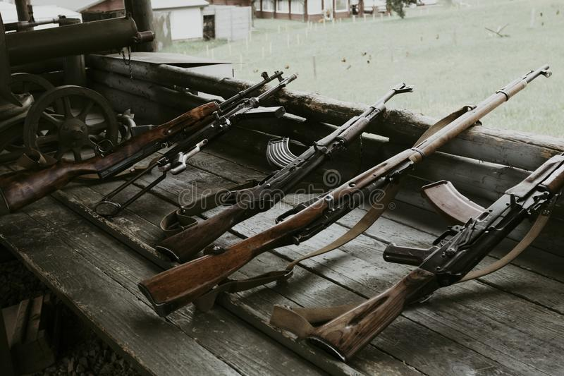Military training. the weapon is at the ready. machine guns, rifles, and machine guns. all different eras. Firearm, army, automatic, steel, metal, equipment stock photos
