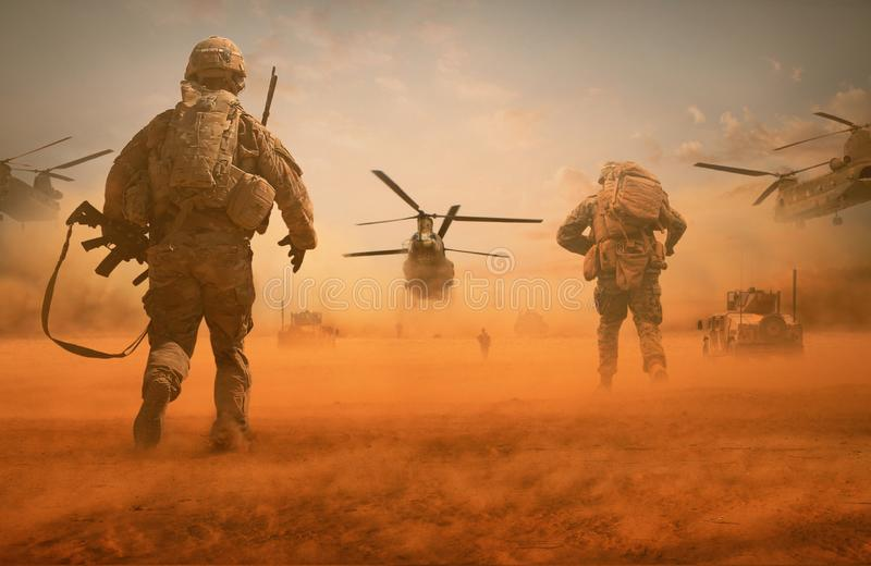 Military troops and helicopter on the way to the battlefield. / Between sand storm in desert stock photo