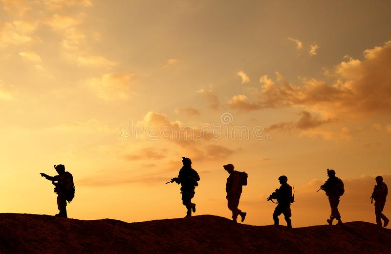 Military troops and helicopter on the way to the battlefield stock image